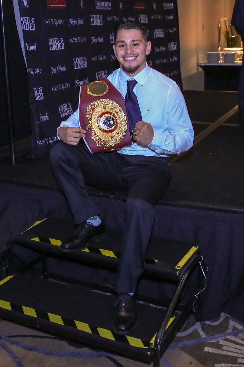 Ruben-Villa-IV-poses-with-the-WBO-Youth-Championship-belt-he-won-in-2018-in-his-11th-pro-fight-at-the-Salinas-Storm-House.-PHOTO-BY-THOMPSON-BOXING-PROMOTIONS
